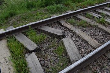 rails and sleepers, on the railway on broken sleepers are rails