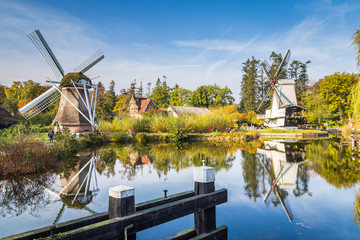 Historic Dutch scene with two windmills