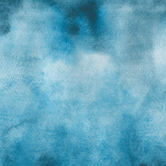 Blue watercolor winter texture with abstract washes and brush strokes on the white paper background.