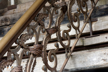 Iron grate on ladder with wooden steps