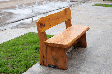 empty wooden bench in the street