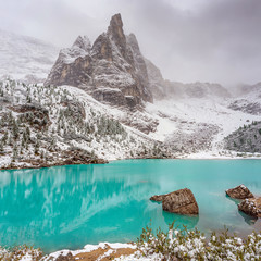 The mountain lake Lago di Sorapiss in Dolomite Alps. Italy, with amazing turquoise color of water.