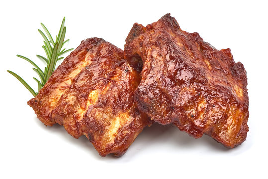 Barbecued and Marinated Sticky Spare Ribs with herbs, isolated on a white background. Close-up