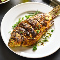 Roasted fish on plate