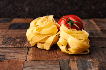 raw fettuccini on wooden table