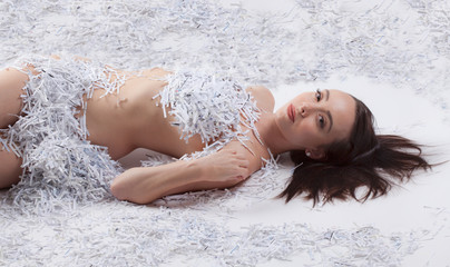 Implied Nude Woman Covered By Shredded Paper