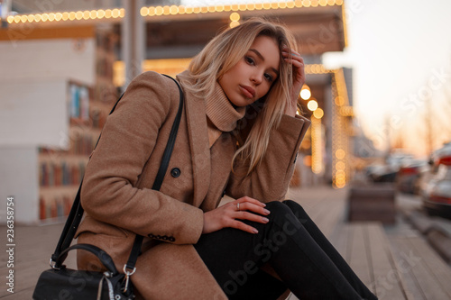 Pretty Attractive Young Blonde Woman In A Stylish Beige Coat