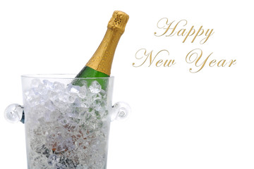 A champagne bottle in a cyrstal ice bucket with the words Happy New Year