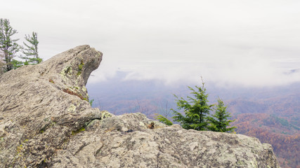 Blowing Rock Mountain and it's beautiful view from the mountain peak into the valley on a partly cloudy day