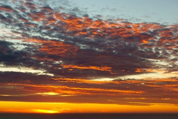 Shining sky over the Pacific Ocean at sunset, Chiloe Island, Chile, South America