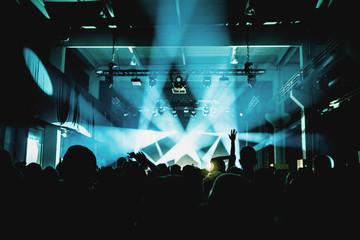 Silhouette people enjoying at music concert in nightclub