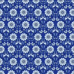 Woodblock printed seamless ethnic floral pattern. Traditional oriental ornament of India, garland motif, blue tones on cobalt background. Textile design.
