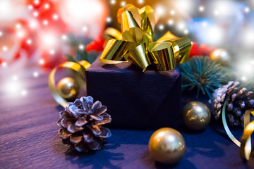 christmas gift with golden bow and baubles