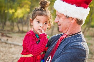 Festive Grandfather and Mixed Race Baby Girl Outdoors