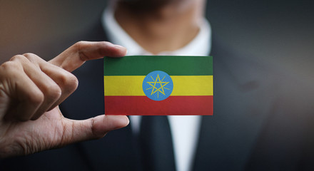 Businessman Holding Card of Ethiopia Flag