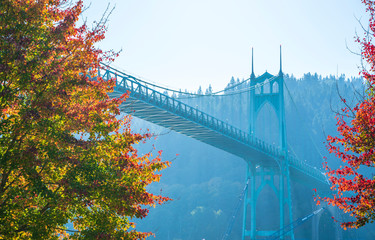 Gothic St Johns bridge in portland surrounded by autumn trees
