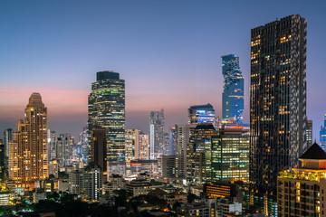 Bangkok City - Aerial view  beautiful sunset  Bangkok city tower downtown skyline of Thailand , cityscape at night  , landscape Bangkok Thailand
