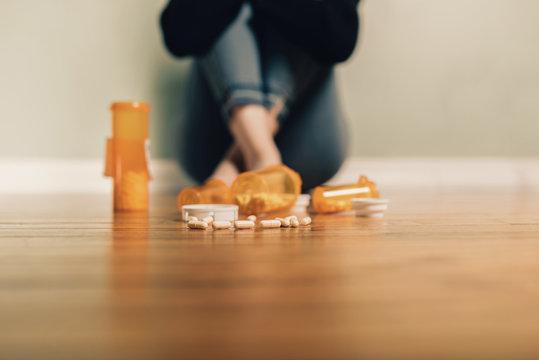 Caucasian female contemplating take prescription pills