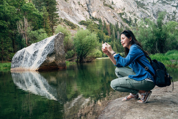 woman taking picture of amazing nature view