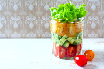 Fresh vegetable salad in a mason jar. Trends in healthy eating.