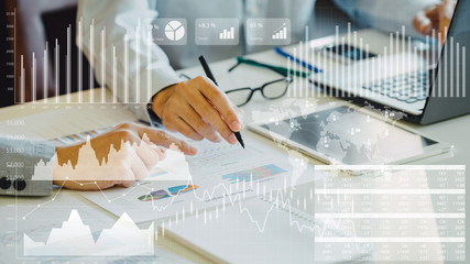 businessman investment consultant analyzing company financial report balance sheet statement working with digital graphs. Concept picture for stock market, cash, fund,and business economy flow. Wall mural