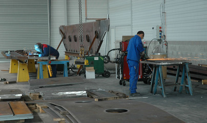 Employed in overalls working in french industrie