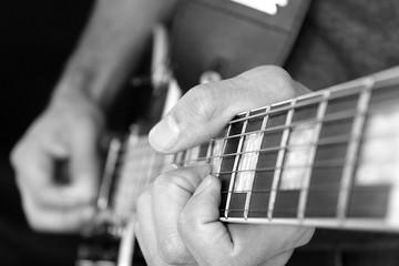 Gitarrist, Finger auf der Griffbrett