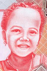 Gambian girl, portrait from Gambian money