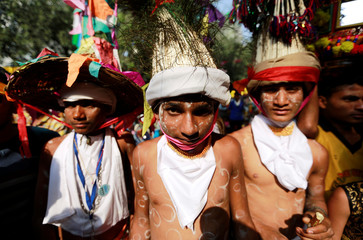 Farmers in their traditional attire attend a rally to protest soaring farm operating costs and plunging prices of their produce, in New Delhi