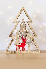 Christmas decoration with wooden deer and trees and space for your content