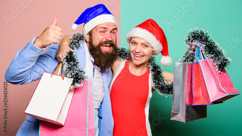 christmas shopping gifts happy couple in santa claus hat family celebrating christmas