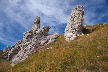 Panoramic view of the towers and spiers of the southern Grigna from the direct route, on a sunny autumn day.