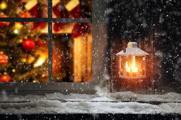 Christmas window sill of snow and ice and home interior