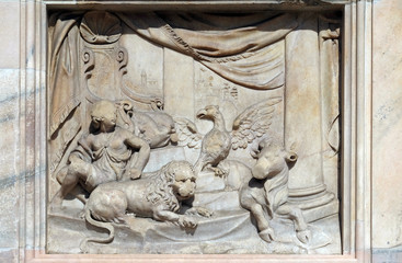 Throne of God and Four Living Creatures, marble relief on the facade of the Milan Cathedral, Duomo di Santa Maria Nascente, Milan, Lombardy, Italy