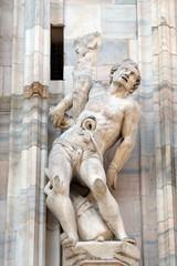Martyrdom of Saint Erasmus, statue on the Milan Cathedral, Duomo di Santa Maria Nascente, Milan, Lombardy, Italy