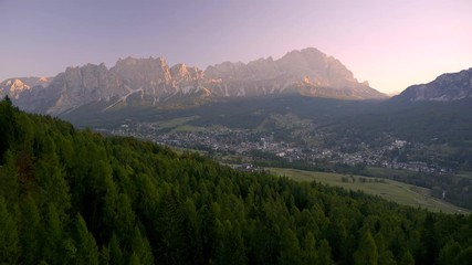 Wall Mural - Scenic sunrise over Italian Dolomites near Cortina d'Ampezzo. Early morning shot of autumn mountains with colorful trees in first rays of sunlight.