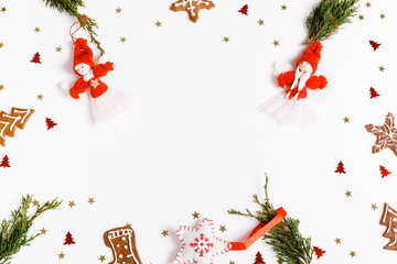 Christmas composition of homemade Angels and christmas tree on white background. Top view, flat lay, copy space.