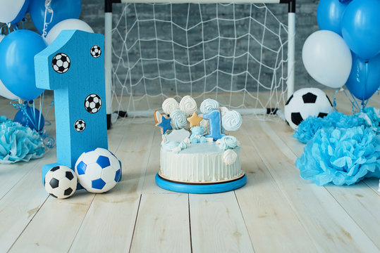 Festive background decoration for birthday with cake, letters saying one and blue balloons in studio, Boy Birthday .Cake Smash first year concept. birthday greetings.
