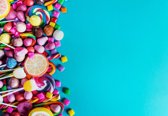 sweets, lollipop, chewing gum, candies etc on blue background