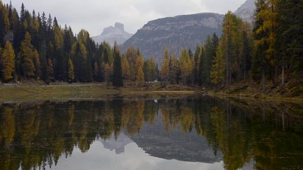 Fototapete - Autumn landscape of Antorno lake with famous Dolomites mountain peak of Tre Cime di Lavaredo in background in Italian Dolomites.