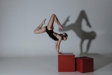 Woman dancer on grey background