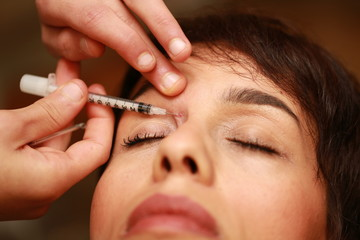 Injection Botox on eyes