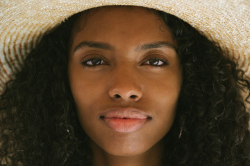 Portrait of a woman with straw hat