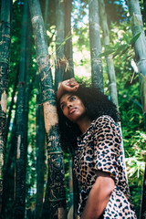 Beautiful woman in a beautiful bamboo forest enjoying the moment