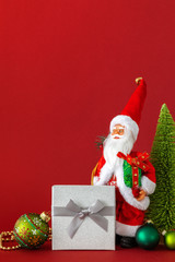 Santa Claus figure silver gift box and red background