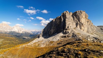 Wall Mural - Colorful scenic time-lapse of majestic Dolomites mountains in Italian Alps. Landscape shot of colorful trees and rocky mountains in the the Italian Dolomites during autumn time.