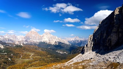 Fototapete - Colorful scenic time-lapse of majestic Dolomites mountains in Italian Alps. Landscape shot of colorful trees and rocky mountains in the the Italian Dolomites during autumn time.