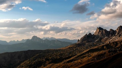 Wall Mural - Beautiful sunset time-lapse shot of majestic Dolomites mountains in Italian Alps. Landscape shot of high rocky mountains in the the Italian Dolomites during Autumn time.
