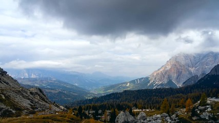 Fototapete - Colorful scenic time-lapse shot of majestic Dolomites mountains in Italian Alps. Landscape timelapse footage of colorful trees and rocky mountains in the the Italian Dolomites during autumn time.