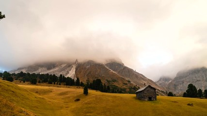 Fototapete - Wooden rural farmer's shed (hut) in Seiser Alm meadow in the Dolomites, North Italy, Sudtirol (Trentino / Alto Adige).